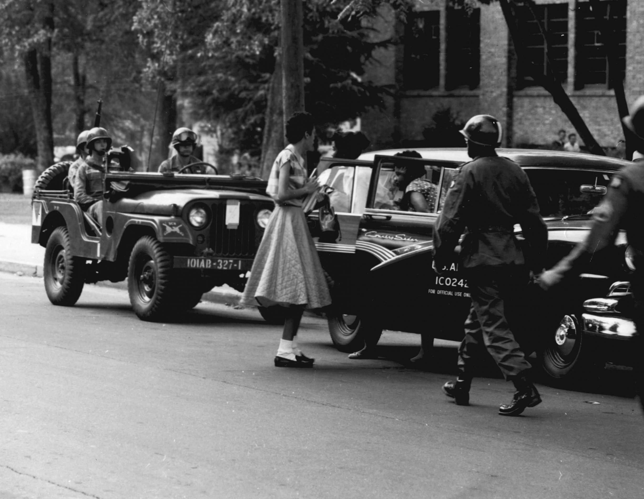 Soldiers from the 101st Airborne Division escort African-American students to Central High School in Little Rock in Sept. 1957, after the governor of Arkansas tried to enforce segregation. Photo courtesy National Archives. Operation Arkansas. Photo by The U.S. Army. (CC BY 2.0).