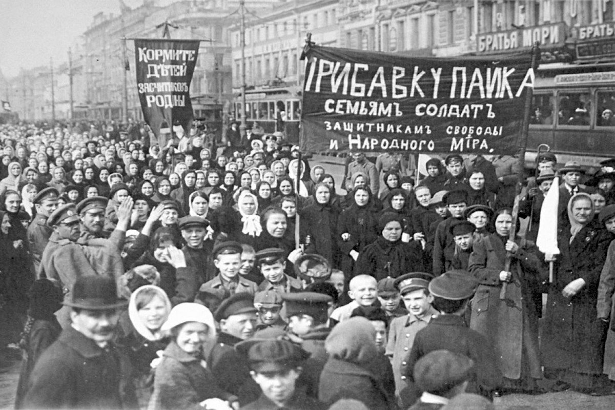 A demonstration of workers from the Putilov plant in Petrograd (modern day St. Peterburg), Russia, during the February Revolution. The left banner reads (misspelt)