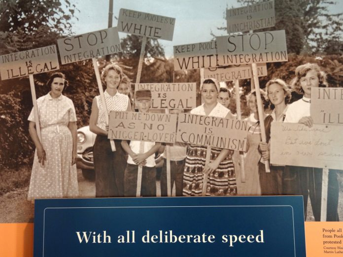 Pro-Segregationists with Quote from Supreme Court Decision on Integration demonstrating for segregation september 1957 in Little Rock. Central High School Visitors Center - Little Rock - Arkansas - USA. Photo of picture taken on May 16, 2012 by Adam Jones. (CC BY-SA 2.0).