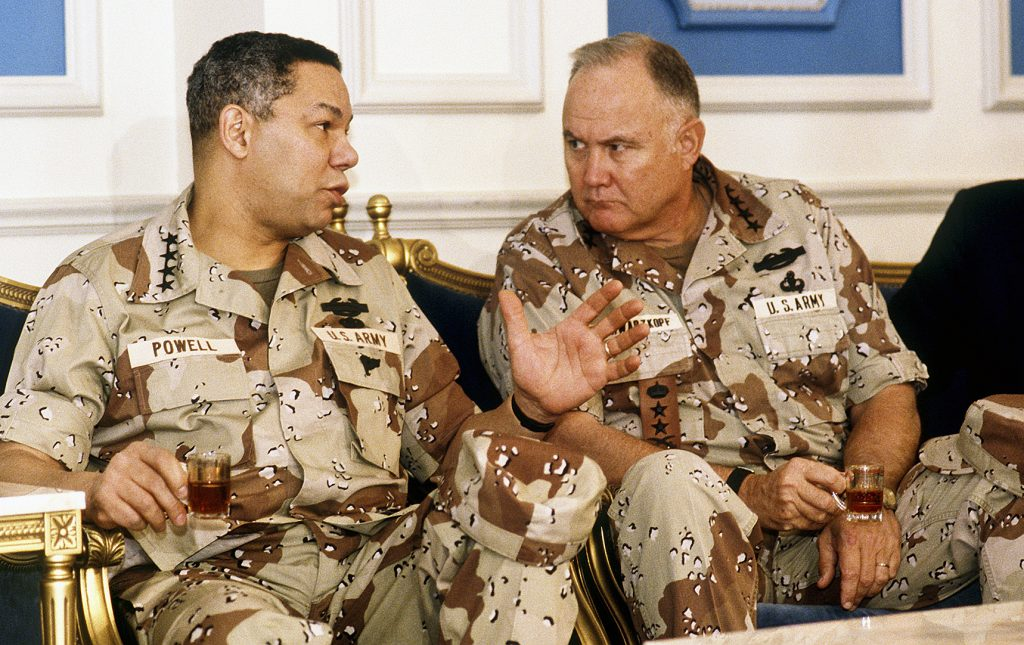 Army Gen. Norman H. Schwarzkopf consults with then-Chairman of the Joint Chiefs of Staff Gen. Colin Powell in a meeting regarding the Allied military coalition in Operation Desert Shield. Schwarzkopf, the commander in chief of U.S. Central Command during Desert Shield and Operation Desert Storm, died Dec. 27, 2012, at the age of 78. (U.S. Air Force photo/Tech. Sgt. H. H. Deffner)