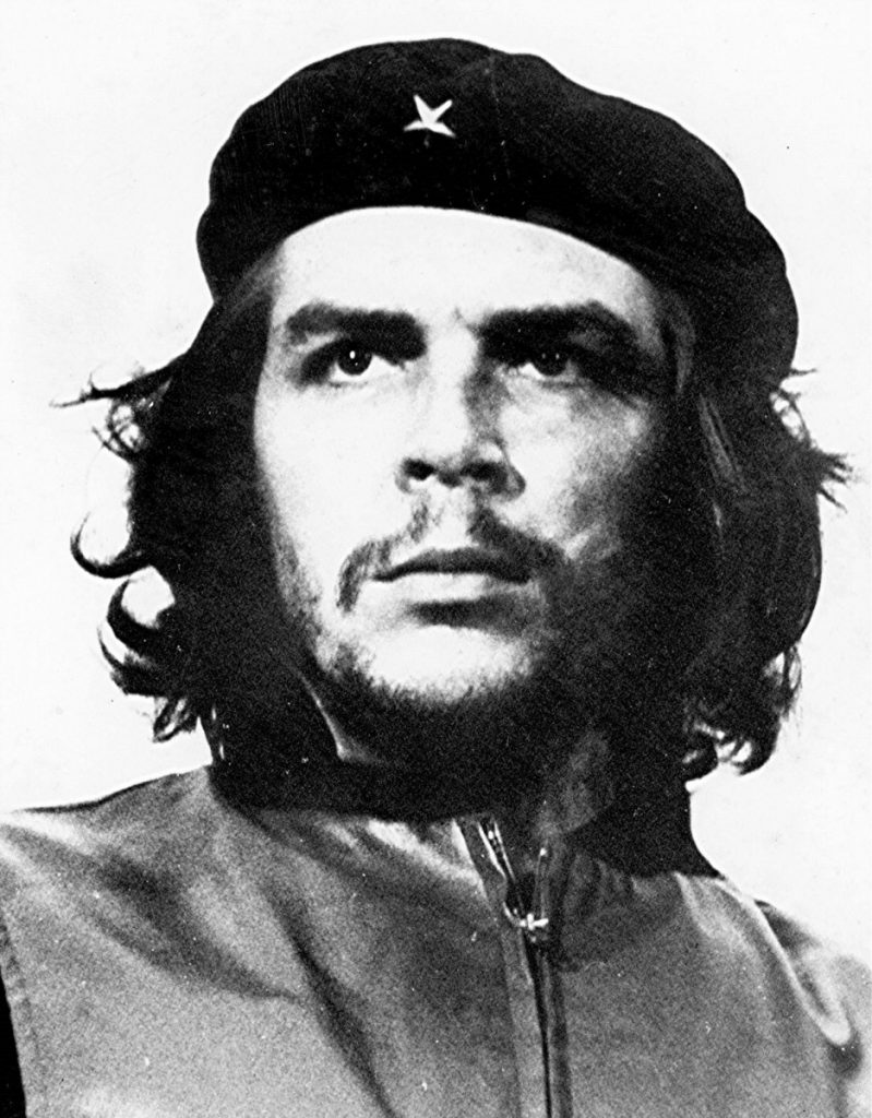 Popularized cropped version of Guerrillero Heroico - Che Guevara at the funeral for the victims of the La Coubre explosion. Date: Photo taken on 5 March 1960; published within Cuba in 1961, internationally in 1967. Source: Museo Che Guevara, Havana Cuba. Photo: Alberto Korda. Poblic Domain.