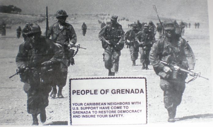 Handbill distributed by US Forces during the invasion of Grenada. The picture, taken the day after the invasion, on October 26, 1983 - includes (foreground) an Army Psychological Warfare leaflet prepared in advance and dropped by US Air Forces during the invasion of Grenada + and (background) Army Rangers marching through on day two finding the leaflets on the ground. Army Psychological Warfare units became operational on the island a few days later, to operate the AN/TRT-22 radio transmitter that replaced the Radio Grenada transmitter destroyed during the fighting. The