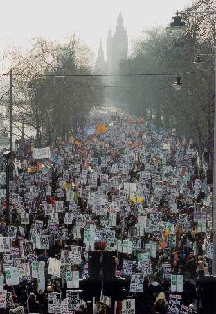 """A protest against the war in Iraq, taken from Hungerford Bridge, in Embankment London. 15th February 2003. Author: Simon Rutherford. (CC BY 2.0) Source: <a href=""""https://commons.wikimedia.org/wiki/File:London_Anti_Iraq_War_march,_15Feb_2003.jpg"""">Wikimedia Commons.</a>"""
