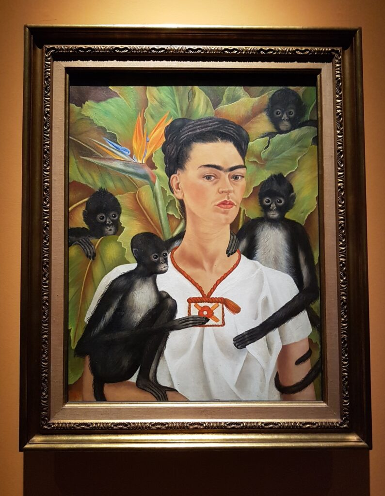 Painting by Frida Kahlo: Self Portrait with Monkeys, 1943, Photo: Taken 3 May 2018 at Mudec Milano by Ambra75. (CC BY-SA 4.0).