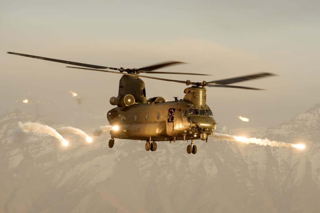 A Royal Air Force Chinook helicopter firing flares over Afghanistan. After thirteen years supporting operations in Afghanistan, all Royal Air Force Chinooks have left Afghanistan and returned to the UK. Photo: Taken on 25 March 2015 by Cpl Lee Goddard/MOD. Open Government Licence version 1.0.
