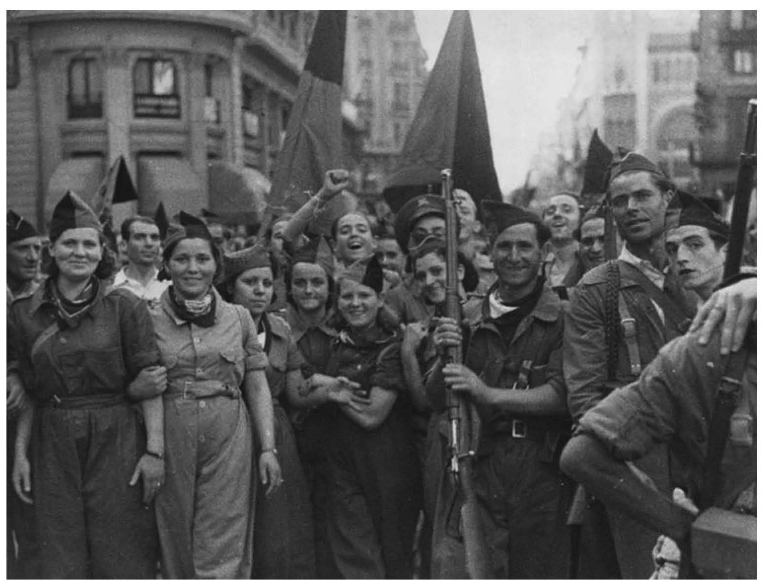Anarchists militia from CNT march on the streets of Barcelona July 1936 during the Spanish Civil War. Photo: Unknown. Public Domain.