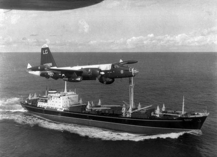 A U.S. Navy Lockheed SP-2H Neptune (BuNo 140986) of patrol squadron VP-18 Flying Phantoms flying over a Soviet freighter. The freighter is most probably the Okhotsk, which left the port at Nuevita carrying 12 IL-28 airplanes on 5 December 1962. Photo: USN. Public Domain.