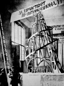 Vladimir Tatlin and an assistant in front of the model for the Third International, November 1920. Photo: Unknown. Public Domain.