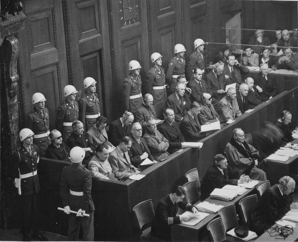 Nuremberg Trials: looking down on the defendants' dock. Ca. 1945-46. Office of the U.S. Chief of Counsel for the Prosecution of Axis Criminality, Photographs relating to Major Nurenburg Trials, compiled 1945 - 1946, NWDNS-238-NT-592. Photo: Ray D'Addario. Public Domain.