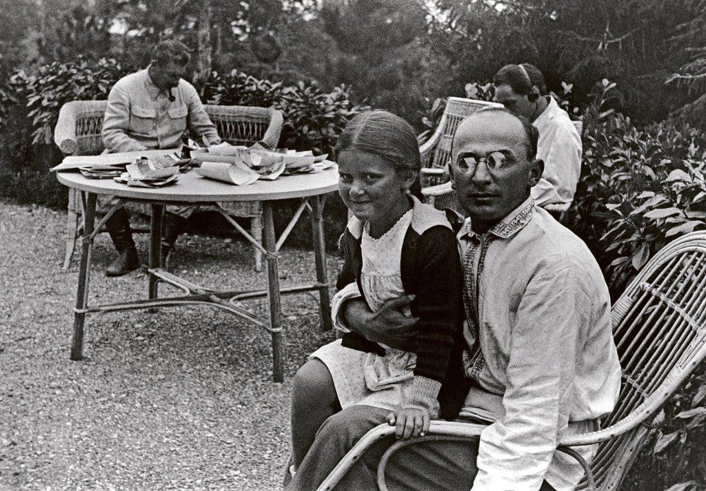 Lavrenti Beria with Stalin & his daughter Svetlana. With headphones: w:Nestor Lakoba. Taken on 25 September 1931. Photo: Unknown. Public Domain.