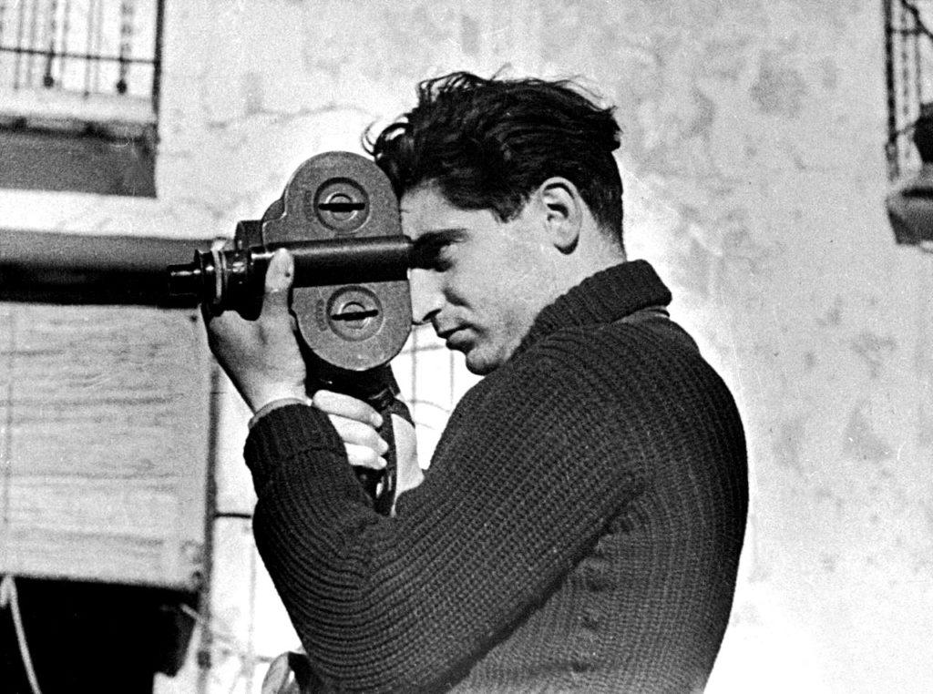 Photographer Robert Capa during the Spanish civil war, May 1937. Photo by Gerda Taro. (1910–1937) Public Domain.