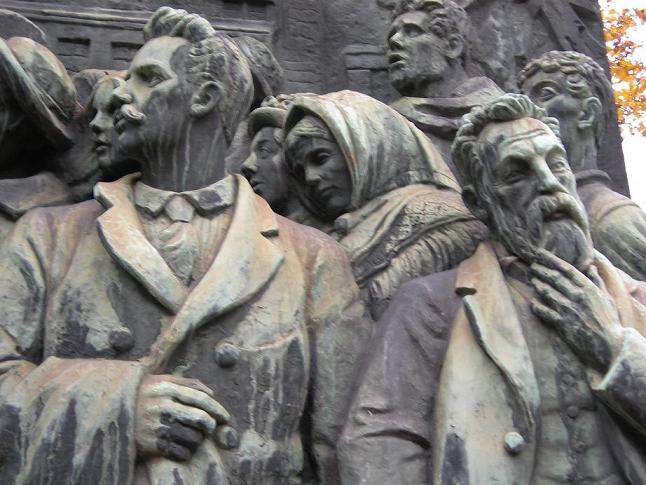 Detail from the Branting Monument showing Axel Danielsson and August Palm. Photo by Bronks November 2005. Public Domain.