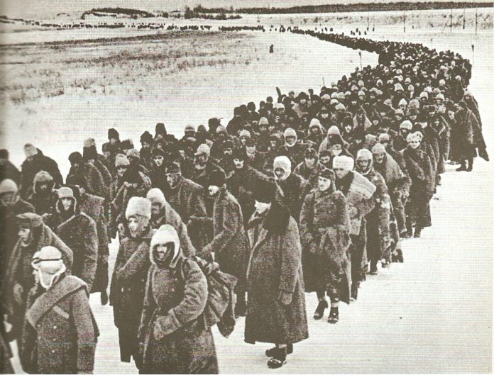"""The """"multinational"""" defeat; Column of Axis prisoners (Germans, Italians, Romanians and Hungarians (1943). Photoreporter: soviet unknown. Public Domain."""