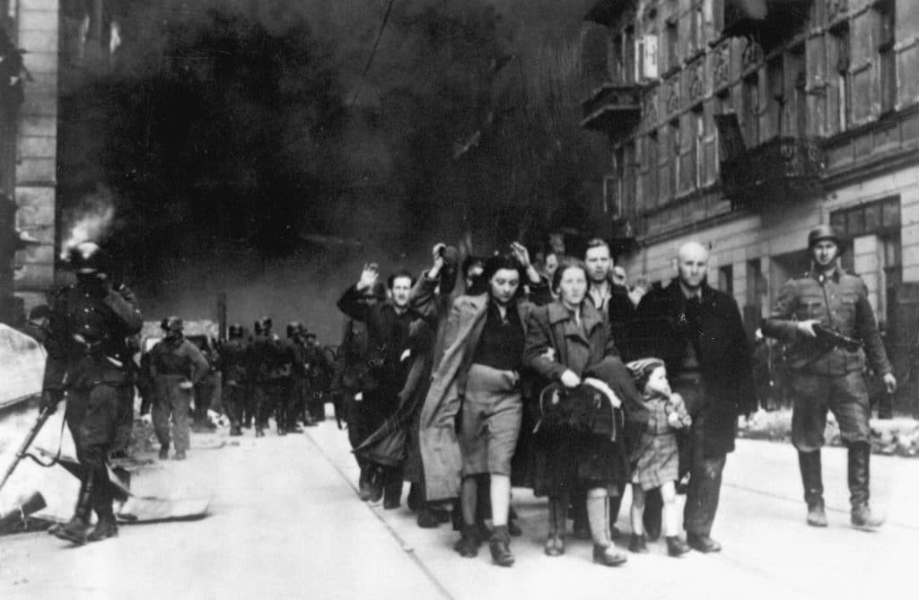 Suppression of Warsaw Ghetto Uprising. Captured Jews escorted by the Waffen SS, Nowolipie Street, 1943. Photo: Unknown/SS. Public Domain.