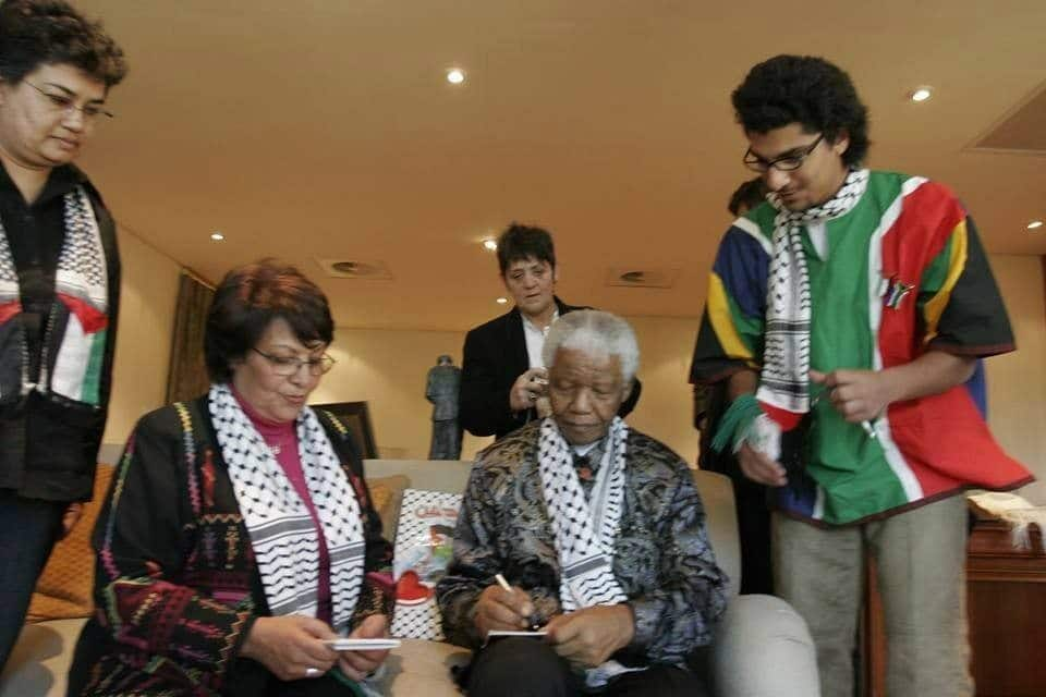 Two freedom fighters: Leila Khaled and Nelson Mandela. Photo by Sana Kassem