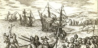 Columbus landing on Hispaniola, October 12, 1492; greeted by Arawak Indians. Litographi by Theodor de Bry (1528–1598), engraver, goldsmith, editor and publisher. based on eyevitnesses. Public Domain.