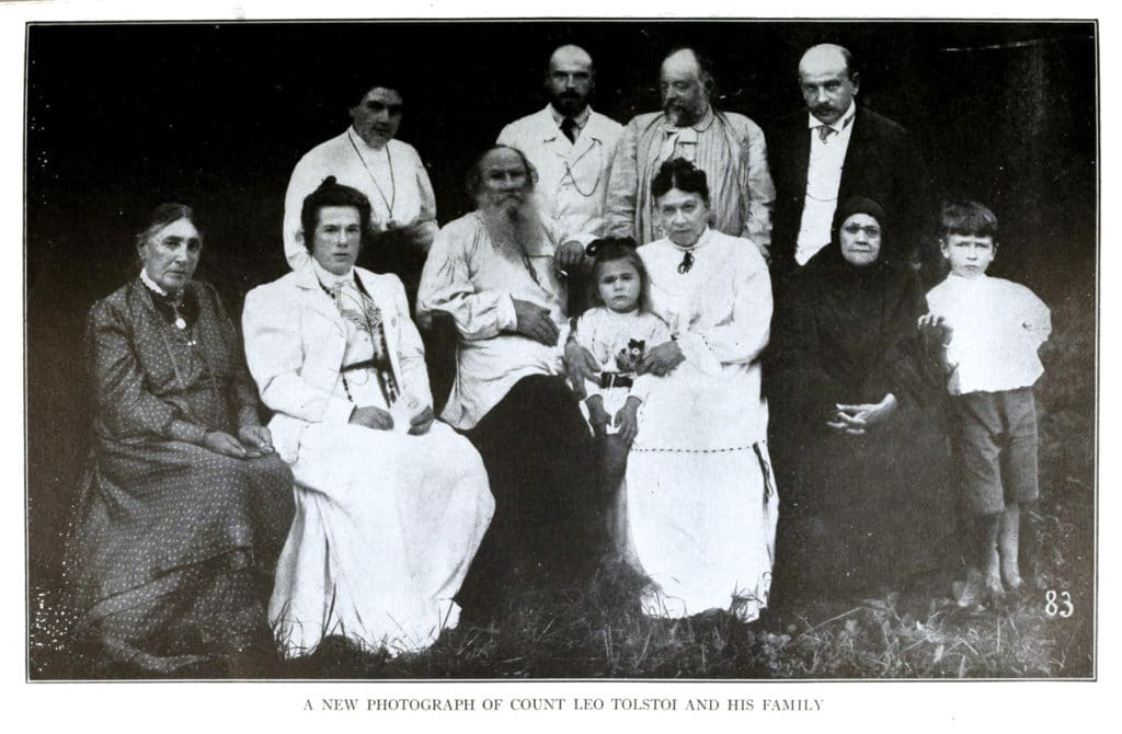 Leo Tolstoy and members of his family in 1908: Seated, left to right: Lisa Obolenski (Marya Tolstoy's daughter), Tatyana (Tolstoy's daughter), Leo Tolstoy, Tanya (Mikhail Tolstoy's daughter), Sofia (Tolstoy's wife), Marya (Tolstoy's sister), Vanya (Mikhail Tolstoy's son). Standing: Alexandra (Tolstoy's daughter), Mikhail (Tolstoy's son), Mikhail Sukhotin (Tatyana Tolstoy's husband), Andrei (Tolstoy's son). From: Tatyana Tolstoy: Tolstoy remembered, Michael Joseph London 1977, ISBN 0 7181 1626 7. Photo: Unknown author. Public Domain.