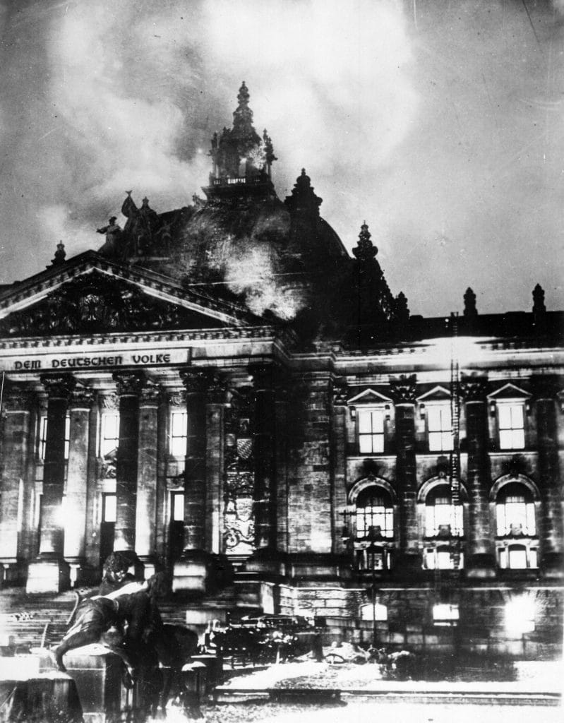 Firemen work on the burning Reichstag, February 1933. Photo: unknown, Item from Record Group 208: Records of the Office of War Information, 1926 - 1951. Public Domain.