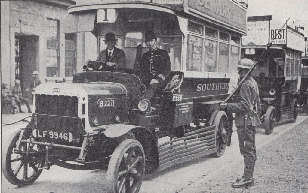 Troops on guard at omnibus station, each bus had a police escort during the General Strike of 1926. Photo: Unknown. Public Domain.