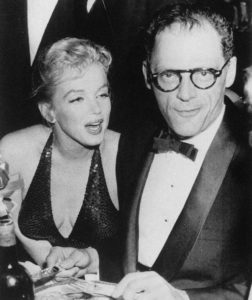 Photo of Marilyn Monroe and Arthur Miller at the April in Paris Ball held at New York's Waldorf-Astoria on 14 April 1957 - They were maried from 1956-1961. Photo by Associated Press Published in the Kingsport Times-News. Public Domain.