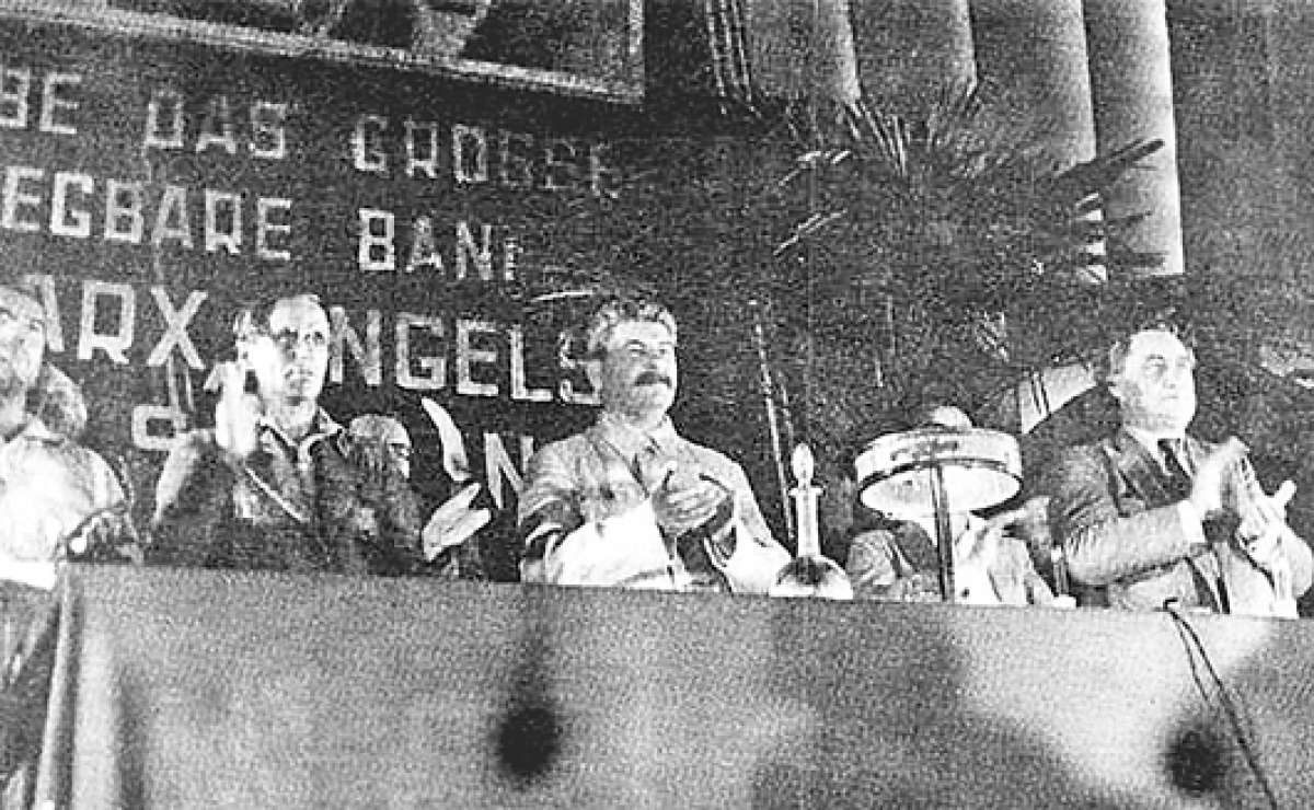 I.V. Stalin and George Dimitrov at the VII Congress of the Comintern. On July 25, 1935, in Moscow, in the Column Hall of the House of Unions, the VII Congress of the Communist International opened. Photo: Unknown. Public Domain.