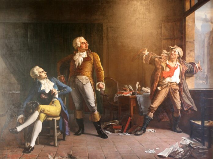 Marat Having a Animated Conversation with Danton (standing) and Robespierre (seated). Oil on canvas painted in 1882 by Alfred Loudet (1836–1898), French painter. Collection: Musée de la Révolution française. Source/Photographer: David Monniaux, 2010-07-03. Public Domain.