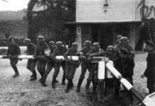 2. WW starts September 1. 1939 with Nazi-Germanys attack on Poland. Free City of Danzig police and custom officials reenact the removal of the Polish border crossing in Sopot on September 1, 1939. Photo: Hans Sönnke. Public Domain.