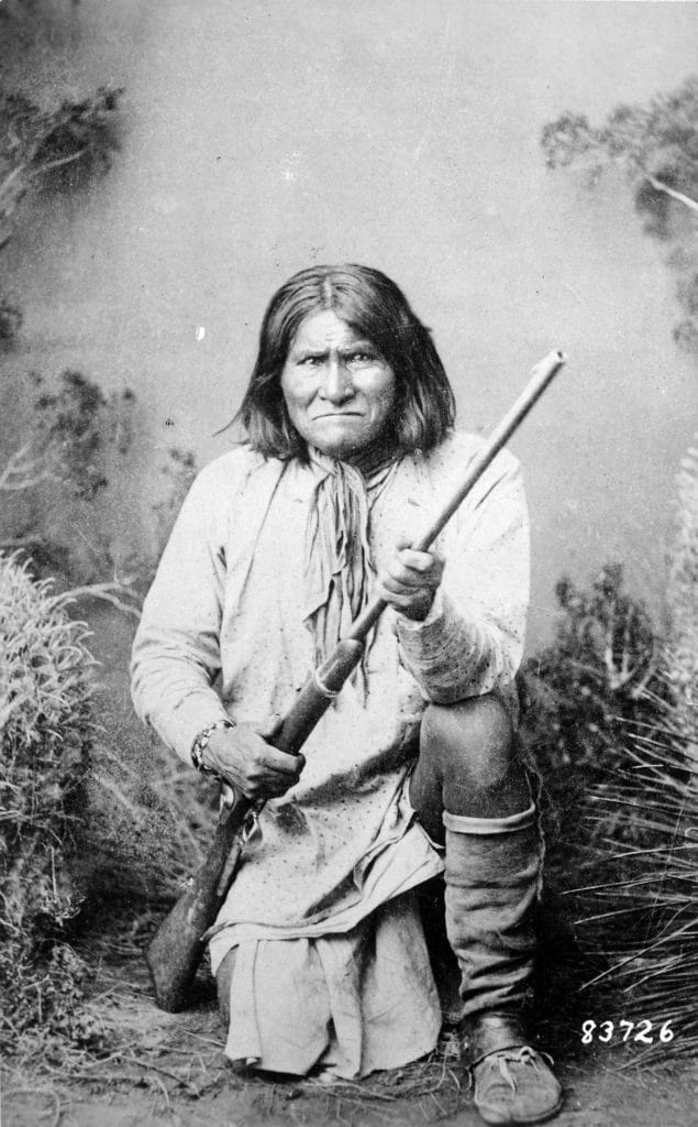 Geronimo (Goyathlay), a Chiricahua Apache; full-length, kneeling with rifle, 1887. Photo: Ben Wittick (1845–1903). Record creator: Department of Defense. Department of the Army. Office of the Chief Signal Officer. (09/18/1947 - 02/28/1964). Public Domain.