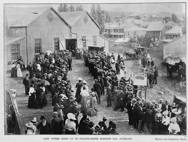 'Lady voters' approach the polling booth at the Drill Hall in Rutland Street, just off Queen Street, Auckland, on 6 December 1899. Despite its striking novelty in international terms, the presence of women at the polling booths - if not yet on the hustings or in Parliament - soon became an accepted part of New Zealand's political scene. The number of women enrolled as electors climbed steadily from 109,461 in 1893 to 163,215 in 1899 and 212,876 in 1905. (Auckland City Libraries)