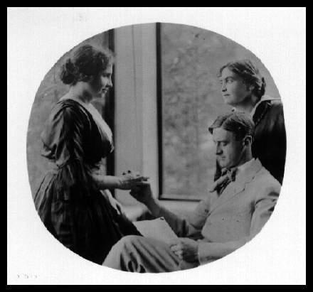 John Macy reads to Helen Keller while Anne Sullivan-Macy watches, ca. 1914. Photo: Whitman Studio, Chelsea, Mass., United States, 1900-1919