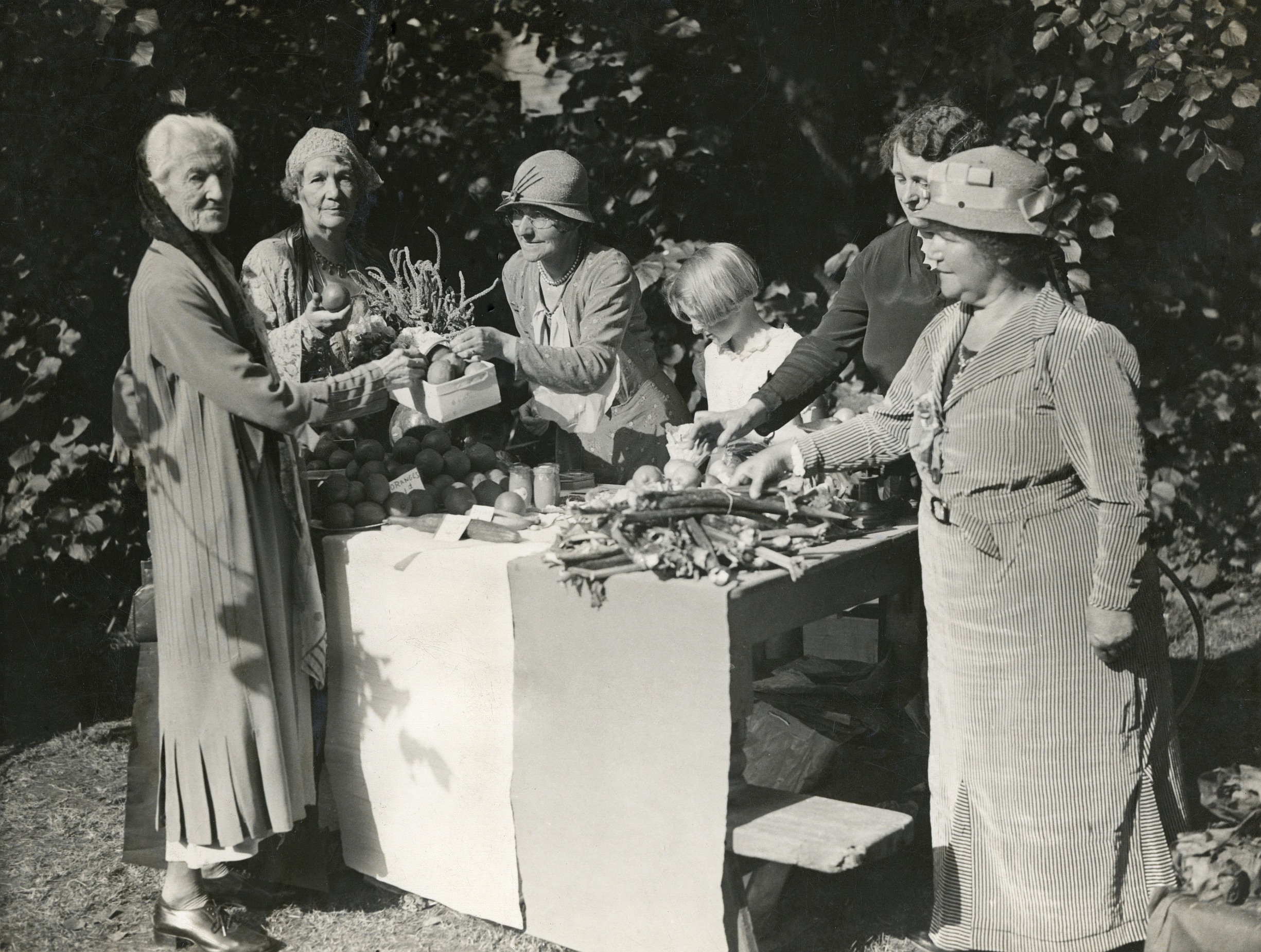 Charlotte Despard and Emmeline Pethick Lawrence buying vegetables from a produce stall; manuscript inscriptions on reverse 'Mrs Pethick Lawrence & Mrs Despard (1930s). Photo: The Women's Library collection/Library of the London School of Economics and Political Science. No known copyright restrictions.