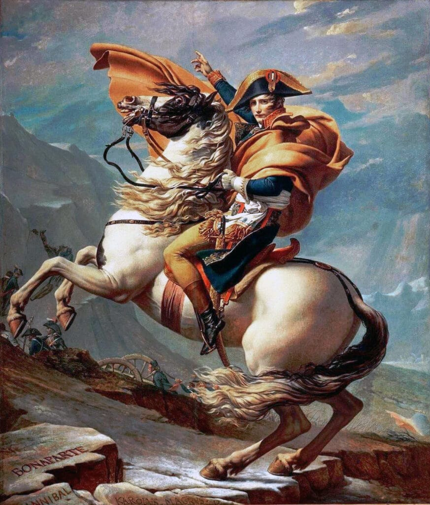 Napoleon Crossing the Alps, 1800. Bonaparte has an orange cloak, the crispin (cuff) of his gauntlet is embroidered, the horse is piebald, black and white, and the tack is complete and includes a standing martingale. The girth around the horse's belly is a dark faded red. The officer holding a sabre in the background is obscured by the horse's tail. Napoleon's face appears youthful. Oil on canvas painted by Jacques-Louis David (1748–1825), French painter and politician. Collection: Musée national de Malmaison et Bois-Préau. Public Domain.