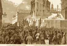 Socialist street meetings were held here during the 1880s and were addressed by Bernard Shaw, Eleanor Marx, William Morris and others. Engraving by JRR from The Graphic, 3 October 1885. Public Domain.