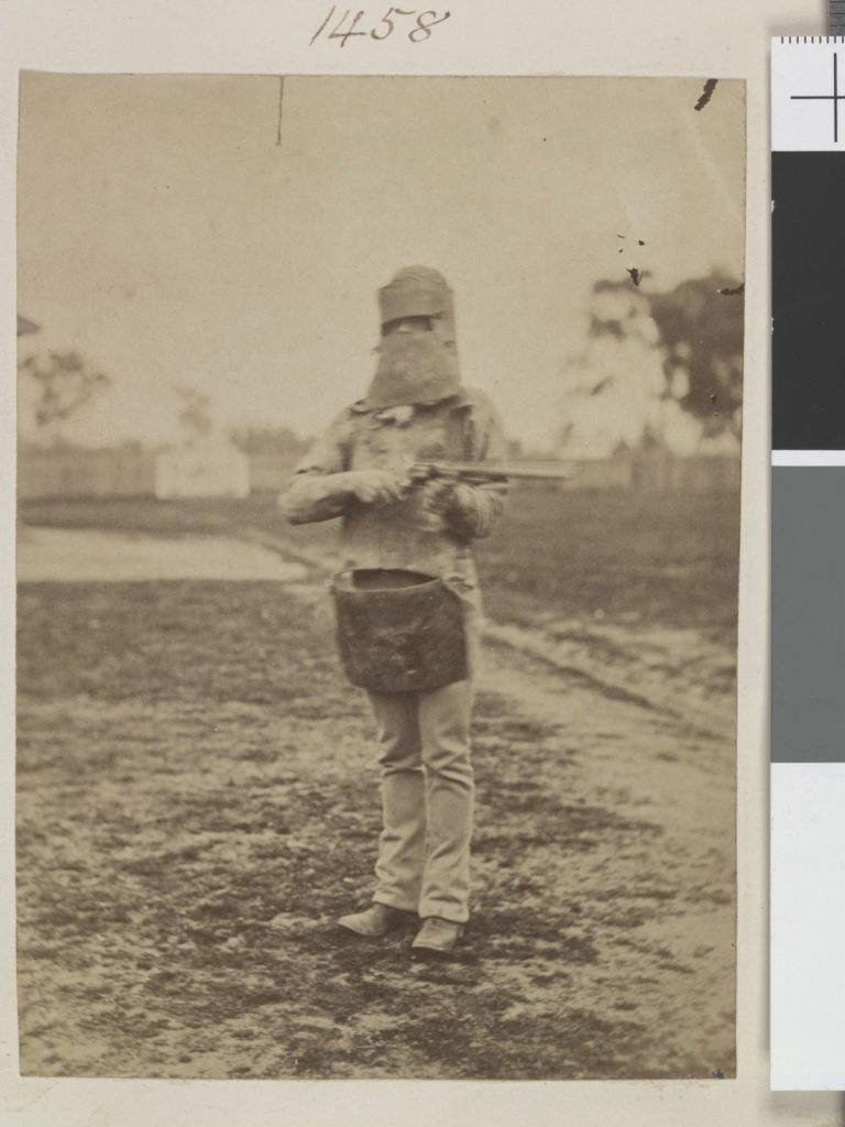 A Policeman equipped in the Ned Kelly armour. Ca. 1880. Photo: Madeley, Oswald Thomas, fl. 1865-1892 photographer.