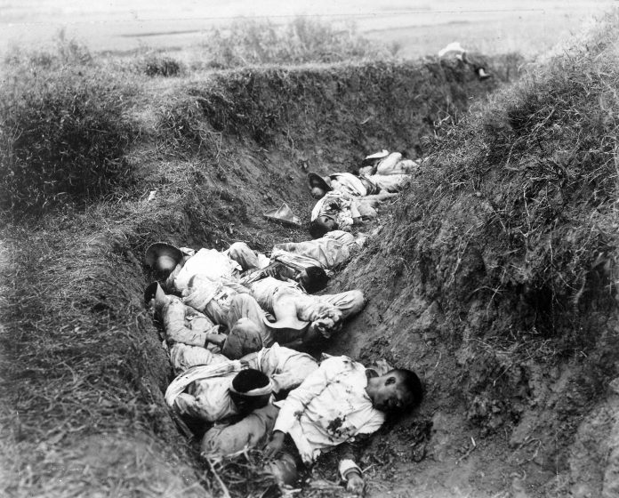 Filipino casualties on the first day of Philippine-American War. Original caption is 'Insurgent dead just as they fell in the trench near Santa Ana, February 5th. The trench was circular, and the picture shows but a small portion.' Date: 5 February 1899. This image is a work of a U.S. Army soldier or employee, taken or made as part of that person's official duties. As a work of the U.S. federal government, the image is in the public domain.