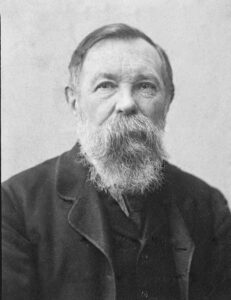 Friedrich Engels (1820-1895). Photography from 1891 by unknown photographer. Public Domain.