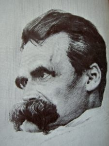 """Drawing of Friedrich Nietzsche by Hans Olde (1855–1917). First appeared in the German magazine """"Pan"""", no. 4 of the fifth year (1899/1900), ca. page 233. Reproduction of a reproduction on a book cover. (1855–1917). Public Domain."""