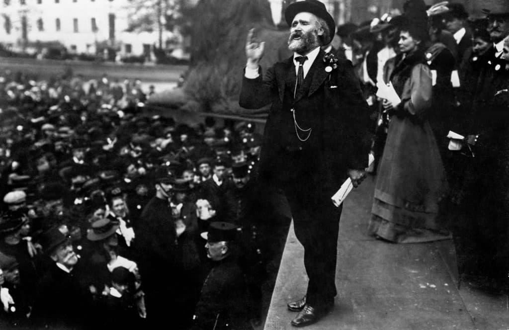 Keir Hardie speaking in 1908 at Trafalgar Square at a Women's Suffrage demonstration. Just behind is the founder of the Women's Social and Political Union, Emmeline Pankhurst. Photo: Unknown. Public Domain.