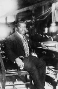 Marcus Garvey, National Hero of Jamaica, seated at desk, 5 August 1924. Photo from George Grantham Bain Collection, U.S. Library of Congress. Public Domain.