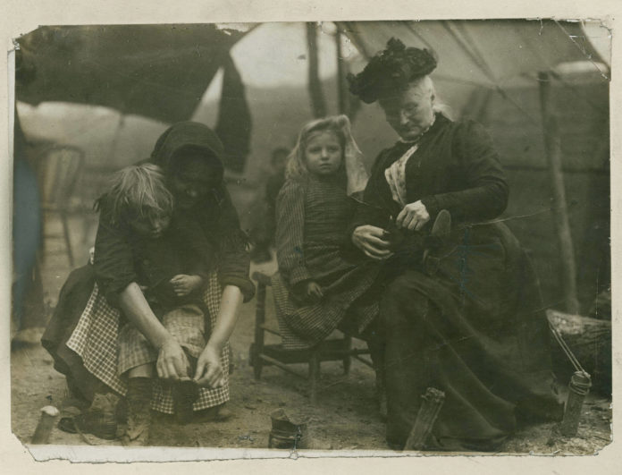 Mother Jones (1837-1930) with the Miners' Children, 1912. Photo: Unknown. Publisher: Newberry Library. Public Domain.