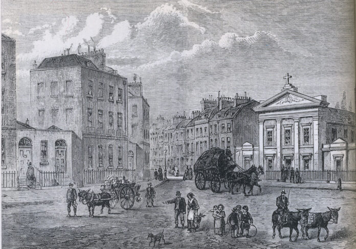 The Polygon, Somers Town in 1850 (from an original sketch). An area of London, where William Godwin had lived there with his wife Mary Wollstonecraft, writer, philosopher and feminist. The area appears to have appealed to middle-class people fleeing the French Revolution. St Aloysius Chapel on right opened 8 April 1808. Engraving by Joseph Swain (1820-1909), English wood-engraver associated with Punch magazine. Public Domain.