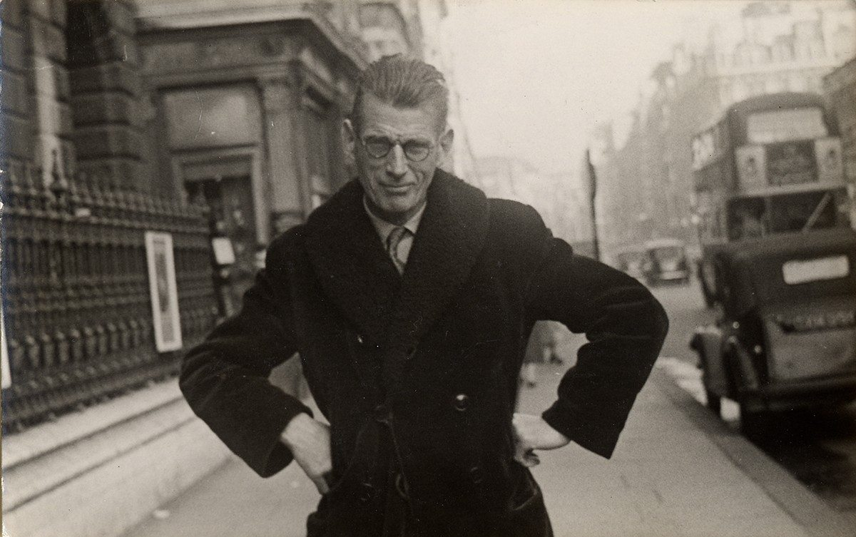 Photograph of Samuel Beckett taken by a street photographer outside Burlington House in Piccadily, ca. 1954. Photo courtesy University of Texas at Austin. Source: montrealrampage.com.