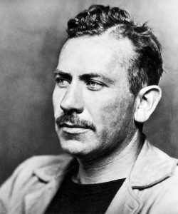 Photograph of John Steinbeck, November 1939. Source: Photoplay, November 1939 (page 22). Photograph is flopped horizontally for magazine publication. Photo: McFadden Publications, Inc.; no photographer credited. Public domain.