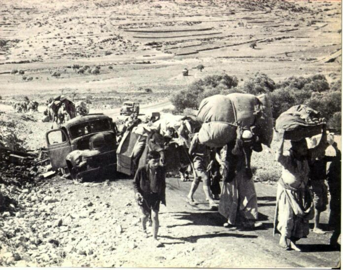 Palestinian refugees. British Mandate of Palestine - 1948. From: Front cover of The Birth of the Palestinian Refugee Problem by Benny Morris. Photo: Unknown. Public Domain.