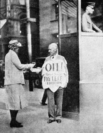 """Upton Sinclair himself, selling the """"Fig Leaf Edition"""" of his book Oil! in Boston, 1927. Author: Anonymous. Public Domain. Source: <a href=""""https://commons.wikimedia.org/wiki/File:Upton_Sinclair_Oil.jpg"""">Wikimedia Commons.</a>"""