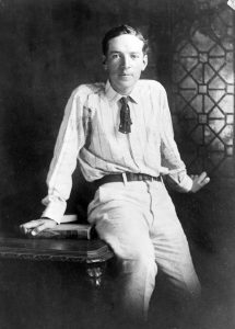 """Upton Sinclair, three-quarter length portrait, seated on desk, facing front. Forms part of: New York World-Telegram and the Sun Newspaper Photograph Collection, 1906. author: Unknown. Public Domain. Source: <a href=""""https://commons.wikimedia.org/wiki/File:Upton_Sinclair_cph.3c32336.jpg"""">Wikimedia Commons.</a>"""
