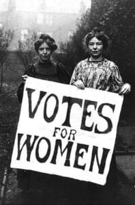 "Sylvia and Christabel Pankhurst, daughters of Emmeline Pankhurst, with sign ""Votes for Women"". Photograph: Unknown. Collection: The National Archives."
