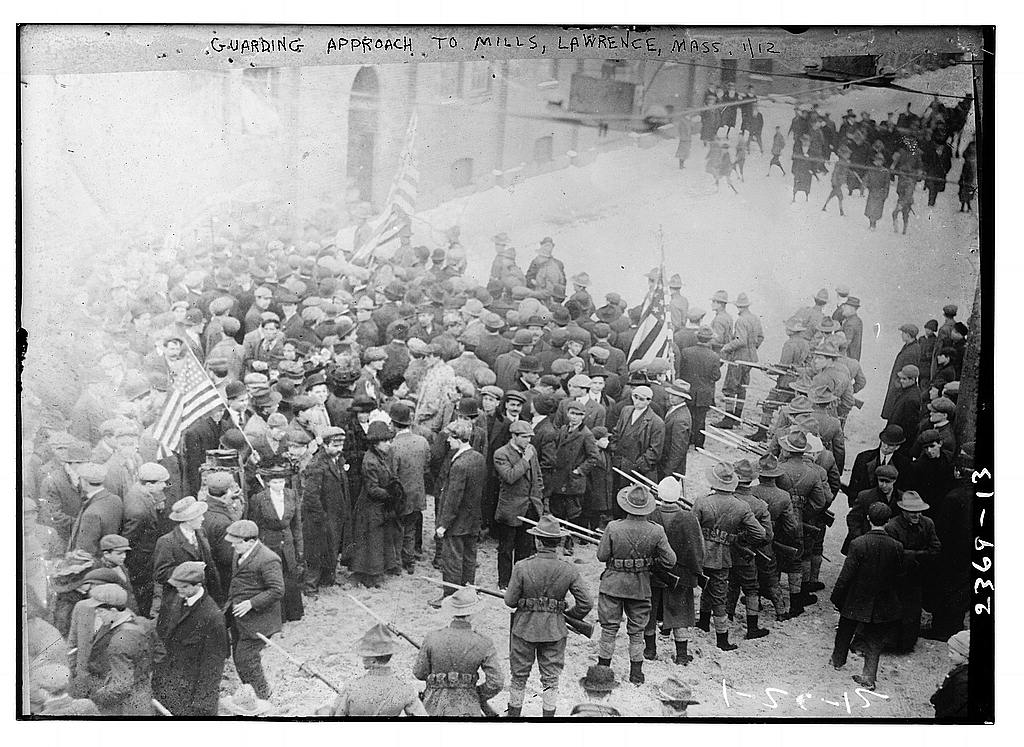 "Guarding approach to mills, Lawrence, Mass.: Photo shows the Lawrence textile strike of 1912, also known as the ""Bread and Roses"" strike. Creator(s): Bain News Service, publisher. Date Created/Published: 1912 Jan. 12 (date created or published later by Bain) From George Grantham Bain Collection/Library of Congress. Public Domain."