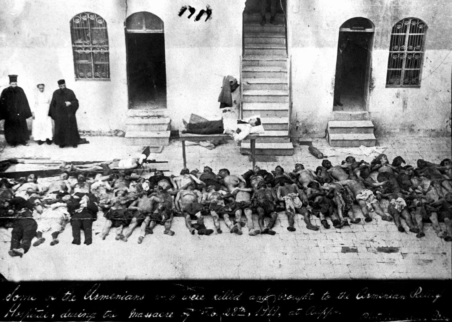 """Victims of the """"Great Slaughter"""" in the northern Syrian city of Aleppo, shown in a photo from 1919. Violence against Armenian centers in eastern regions of the dying Ottoman Empire spiked over the summer of 1915, beginning what historians consider to be the first genocide of the 20th century. AP/ Armenian National Archives."""