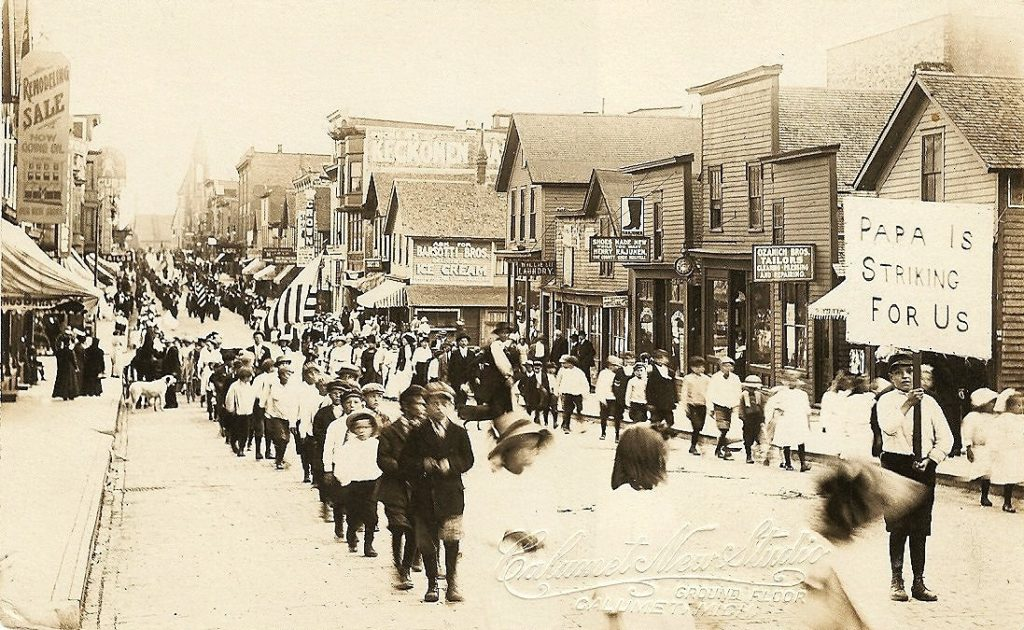 Children's Parade, Calumet Copper Miners Strike. The strike was called on July 23, 1913, and lasted until April, 1914. Photo: RPPC(Real photo postcard) by Calumet New Studio, Calumet, Michigan. (CC BY-SA 2.0).
